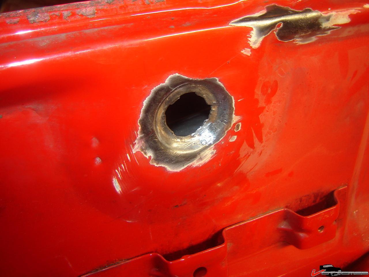 how to fix rust spot bottom of pebblecrtete pool